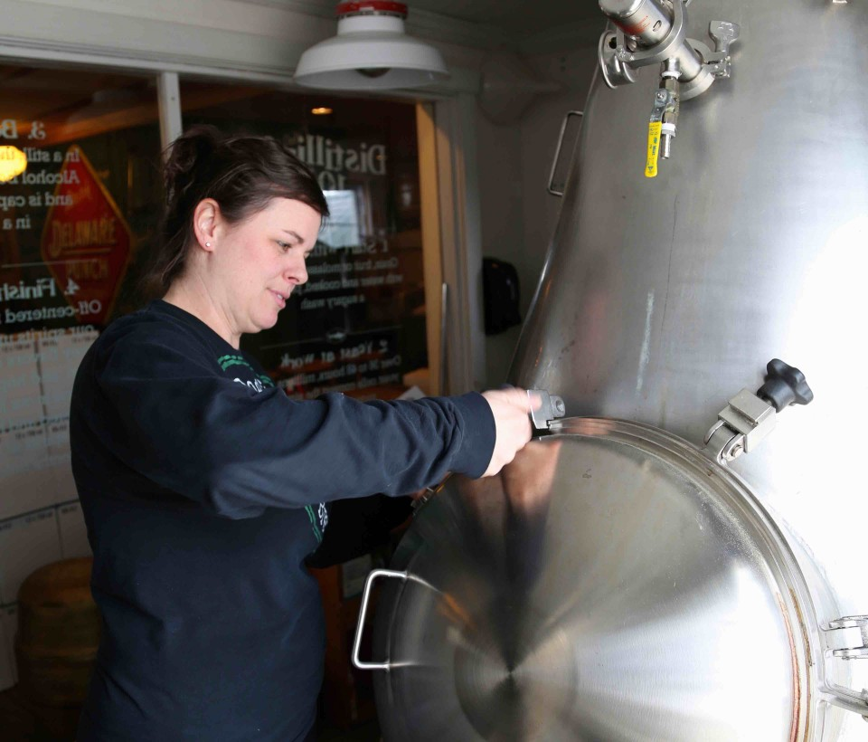 Alison Schrader of Dogfish Head adjusts the
