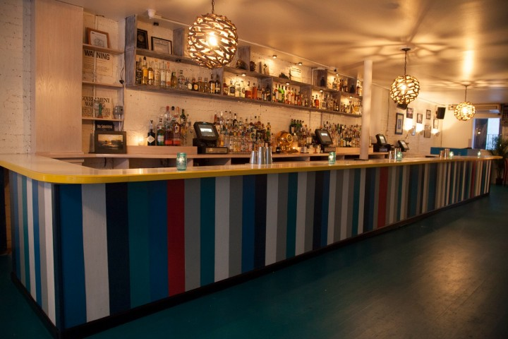 New York City's Lazy Point evokes an urban beach house and boasts a tropically inspired cocktail list, as well as a raw bar, oysters and other upscale small plates–style dishes.