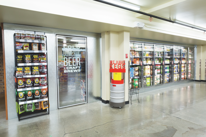 At Beverages and More! (walk-in and grab-and-go coolers pictured), IPA sales are growing faster than the overall craft beer category. The 157-unit retail chain offers over 250 IPAs, which it's currently reorganizing by style rather than by brand—a strategy that promotes sampling.