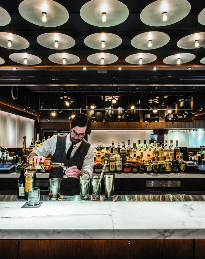 Bartender Manny Sofis mixes cocktails at RPM Steak restaurant in Chicago.