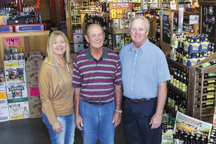 Tops Liquors cofounder Bob Eccles (center) has now retired, leaving co-owners Greg Eccles (right), Trish Ogorek (left) and Lori Eccles DeLoach (not pictured) to run the family business.