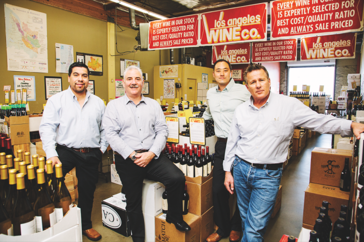 Los Angeles Wine Co. owner Steven Bialek (second from left), pictured with sales managers Daniel Lopez (far left), Henry Oh (second from right) and Charlie Mattera (far right), takes pride in his store's contrast to large chain retailers. While the company has just five employees, its curated selection allows for excellent customer service. Online sales drive higher average transactions and comprise 40 percent of revenue.