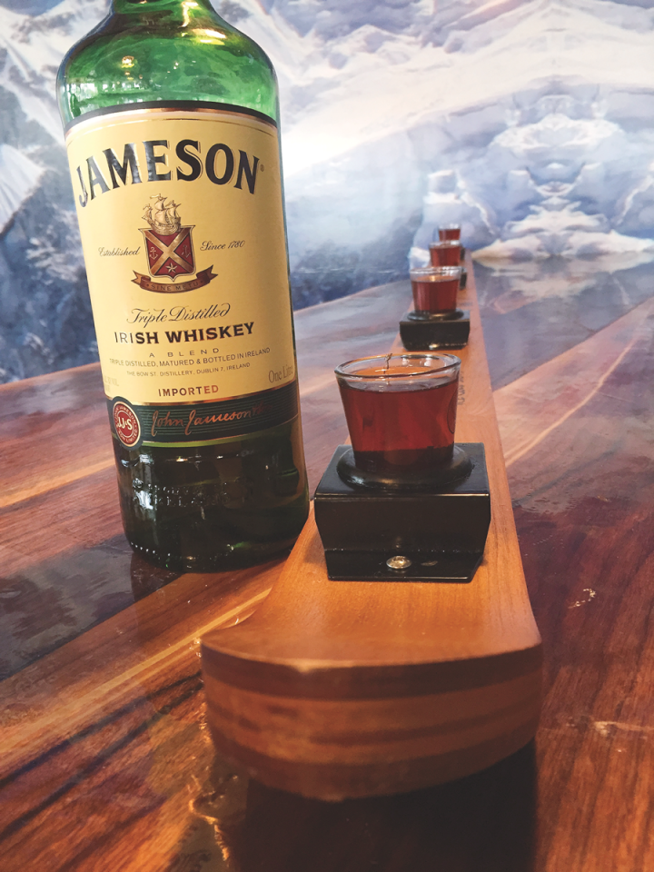"""Embers Ski Lodge in Nashville offers a """"shot ski"""" of Jameson to be shared among four friends, in addition to a selection of other Irish whiskies by the 2-ounce pour and in cocktails like the Shim Sham."""