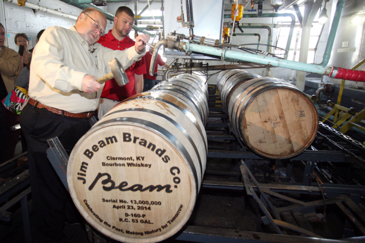 Master distiller Fred Noe (left) and his son, Freddie Noe, lay down Jim Beam's 13-millionth barrel.