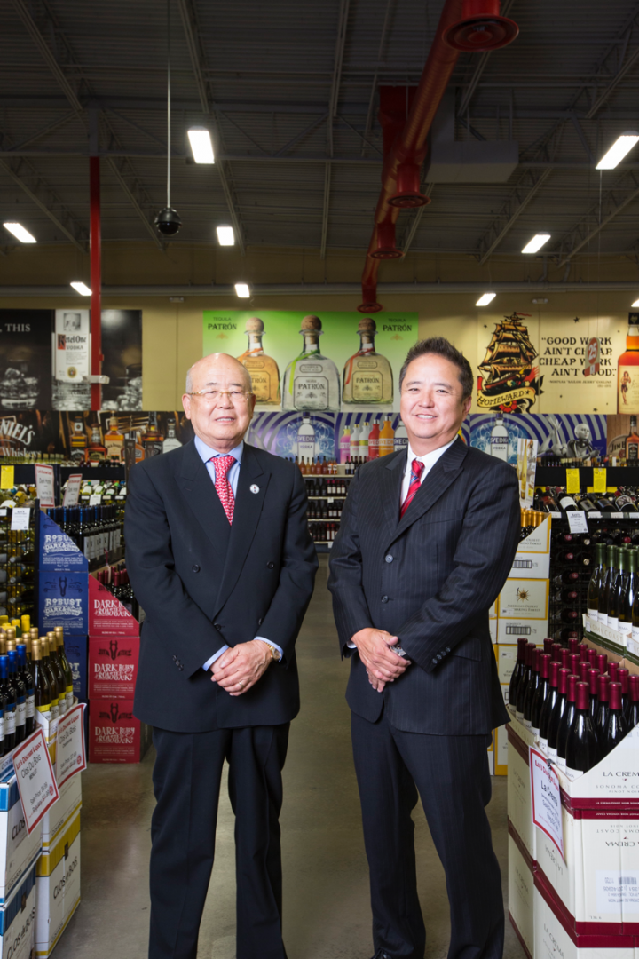 Kenneth Lee (right) and his father, company founder and COO Hae Un Lee, are recognizable figures in Las Vegas due to their tongue-in-cheek advertisements.