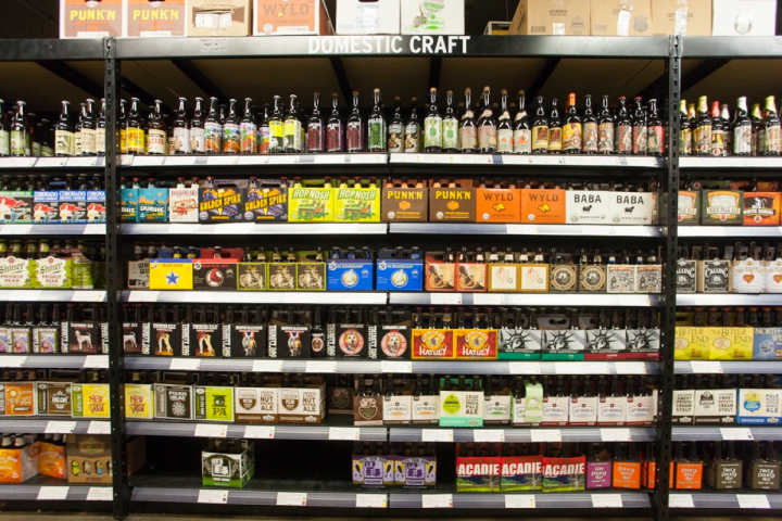 Craft beers are organized by style at Half Time. IPAs are extremely popular and strongly influence consumer taste.