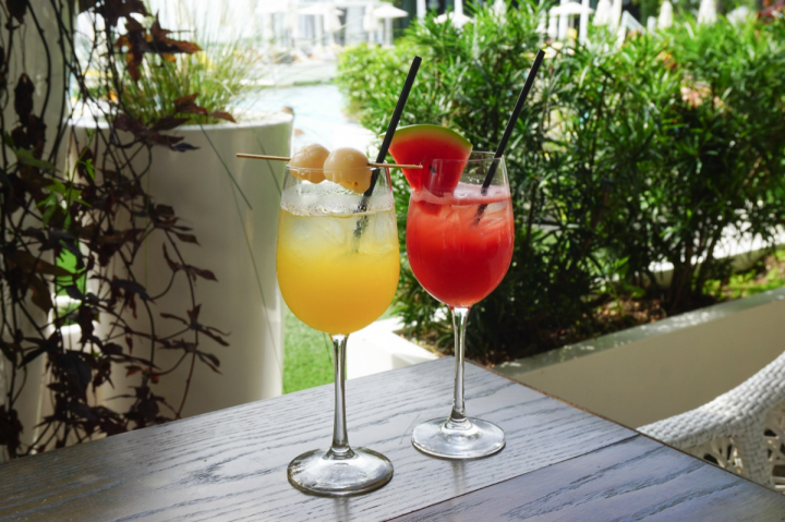 Many consumers are experimenting with classic wine cocktails like sangria. Rather than the traditional sparkling wine, the Lychee Passion Sangria (left) uses riesling and sake, while Watermelon Rose Sangria (right) uses rosé.
