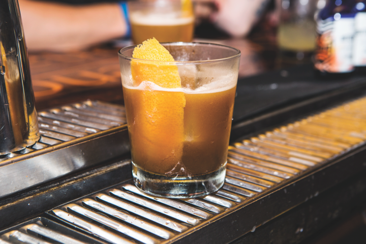 With so much variety, there's a liqueur to fit every drink taste profile. The Champs Élysées Revisited mixes Yellow Chartreuse, amaro, Cognac, lemon juice, simple syrup, aromatic bitters and stout.