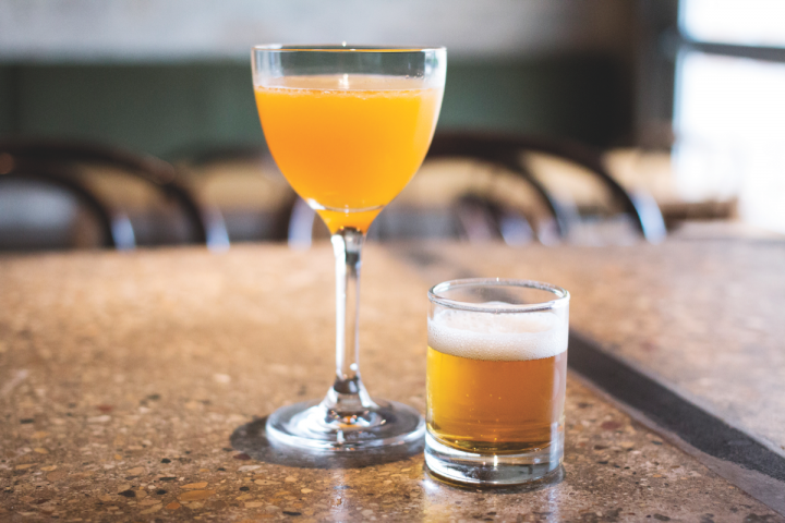 Ada Street's Anji cocktail combines a custom Scotch blend with lemon juice, simple syrup and pepper paste, serving it with a side of Founders All Day IPA.