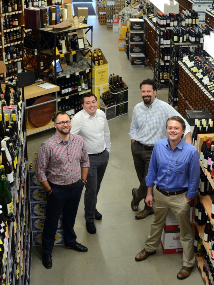 From left: Spirits and beer manager Liam Maloney, wine director Nick Shugrue, owner Gil MacLean and general manager Eric Taylor lead a team of 25 employees at the store.