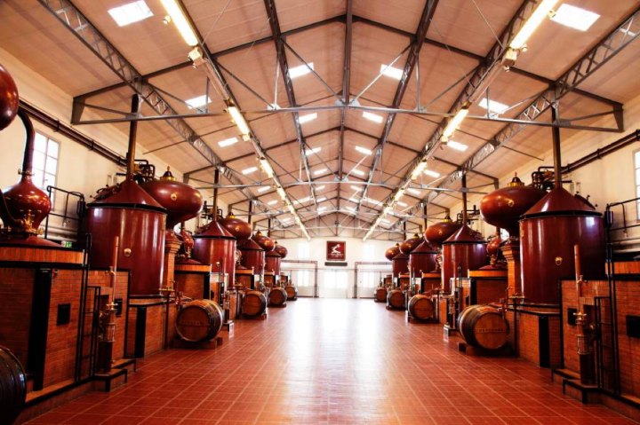Major Cognac brands have refocused on the U.S. market following China's slowdown. Hennessy (distillery pictured) leads with its V.S. expression.