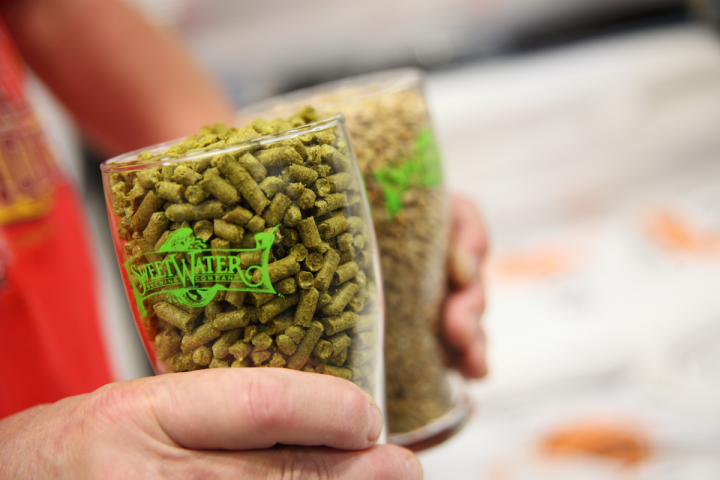 "Some of SweetWater's most popular products use ""hop hash,"" the resin by-product of hop pelletizers (hops pellets pictured), a brewing method that's unique to the brand."