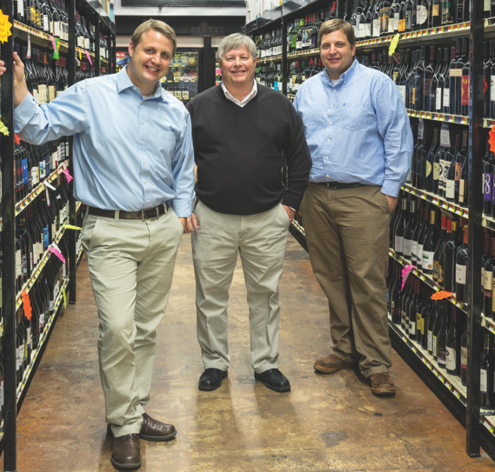 Adam Acquistapace (left) runs the store with his father, Steve (center), and his brother, Erik (right).
