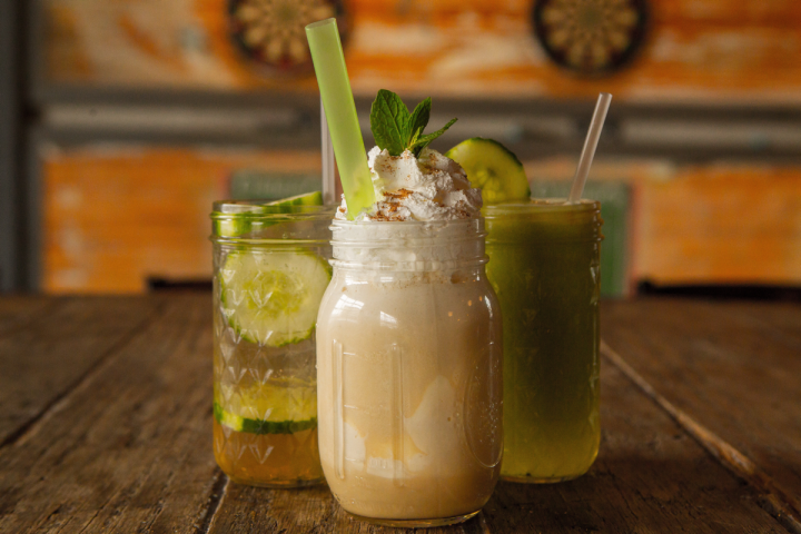 Drinks options range far beyond just punches, wine and beer. Cocktails like the the Jalapeño Cucumber Limeade (left), the Milk-Xologist adult milkshake (center) and The Sharpest (right) are often made with local spirits