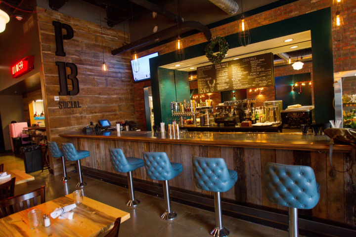 Food and beverage take center stage at Punch Bowl Social, which incorporates multiple concepts, including a diner and a bar, into its floor plan.