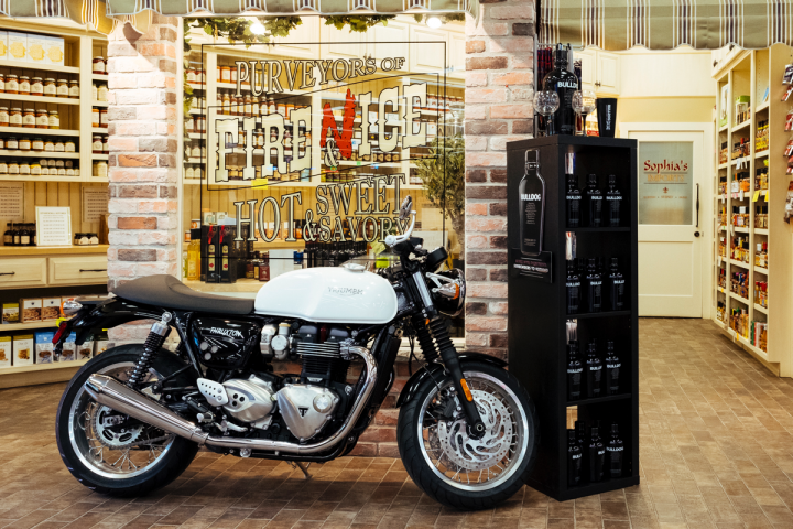 Julio's relies on creative displays to drive interest and draw in shoppers, such as a motorcycle promoting Bulldog gin.