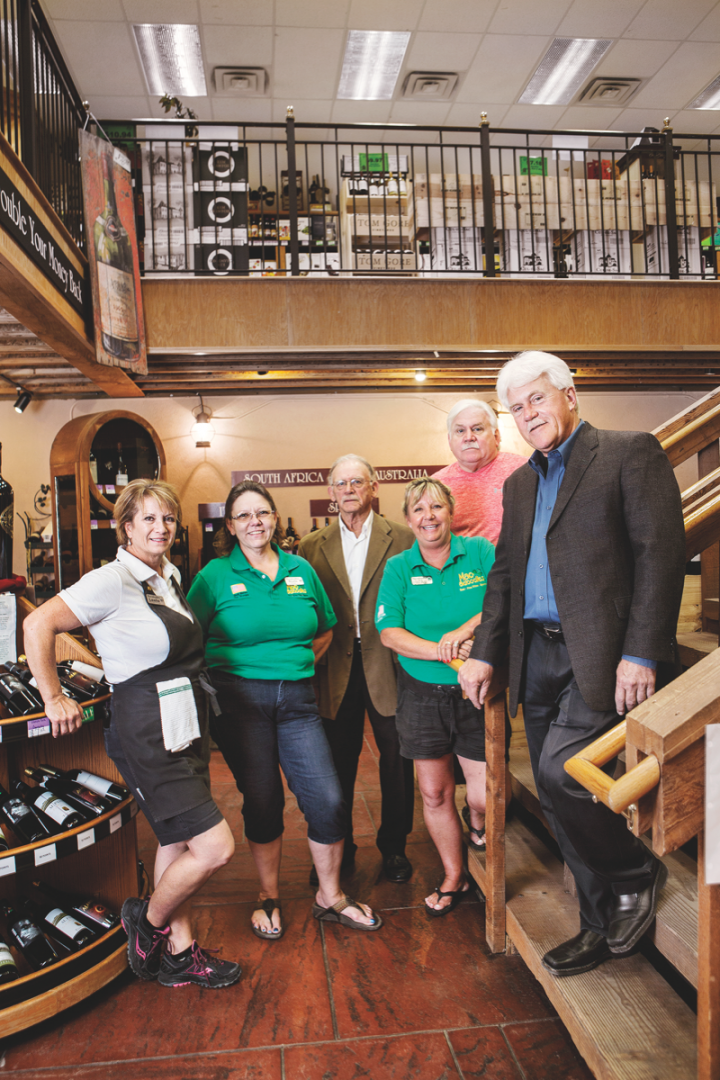 The store's team includes (left to right) wine manager Leslie Santa Maria, assistant manager Sheila Kirkpatrick, cofounder Bob McCurry, lead cashier Cathy Miles, partner John Gildehaus and Roger Gildehaus.