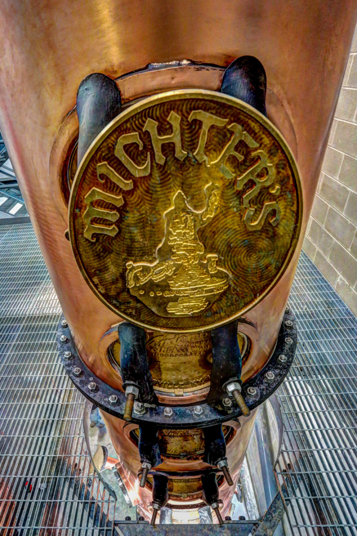 New distilleries like Michter's in Louisville, Kentucky (column still pictured), and expansions to existing facilities are driving Bourbon's growth.
