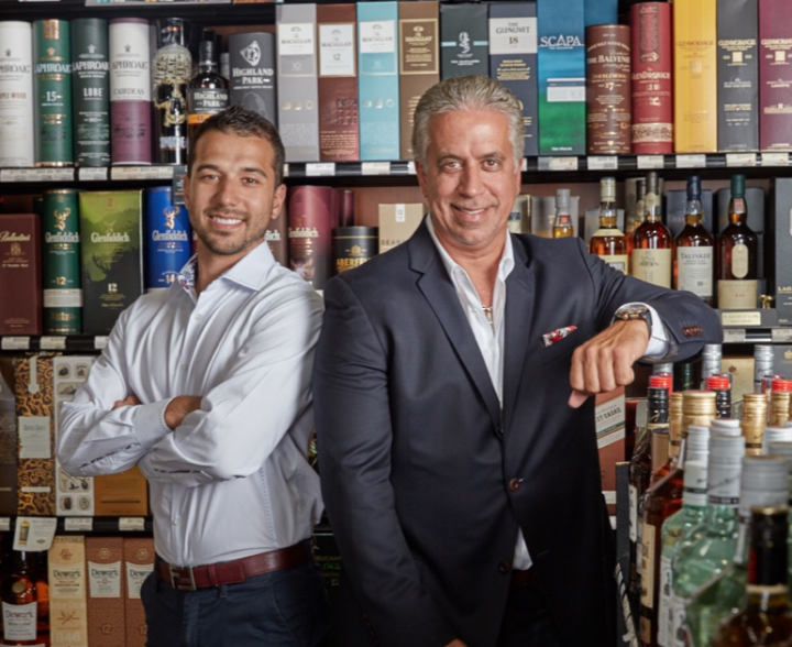 Jose Barrios II (right) owns Vintage Liquor & Wine Bar, which has three units in the Miami area. His son, Jose Barrios III (left), manages the Midtown Miami location.