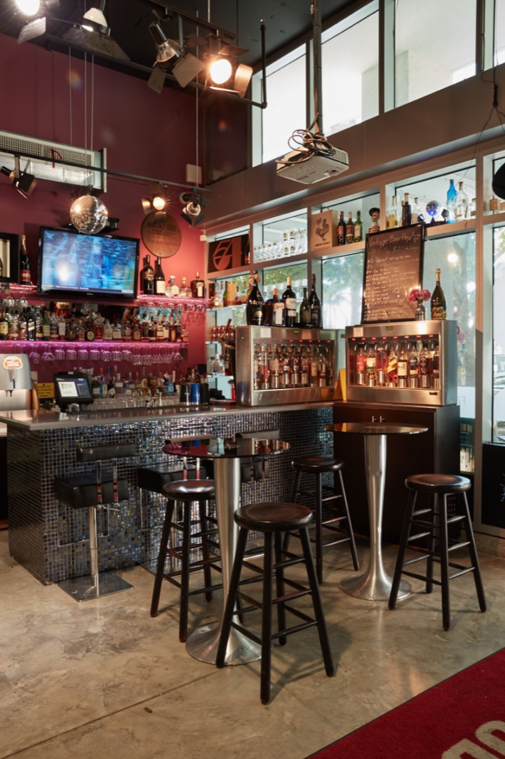 The Midtown location of Vintage Liquor features a full bar (pictured), and customers can shop the store while drinking a cocktail.