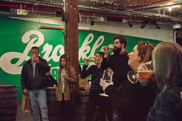 Brooklyn Brewery (taproom pictured) plans to remain in Williamsburg through at least 2025. The company is considering expansion of its production facilities to another site in New York City's Staten Island borough or the state's Hudson Valley area.