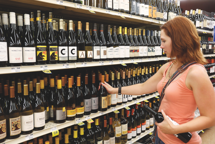 A shopper chooses wine at the Food City grocery store in Maryville, Tennessee. The state began allowing grocers to sell wine in July 2016—and more legislation is on the table.