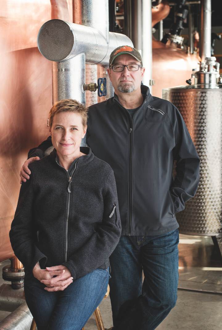 Copper & Kings cofounder Joe Heron (pictured with wife and cofounder Lesley Heron) believes the acquisitions by larger companies are building a healthy American distilling industry.
