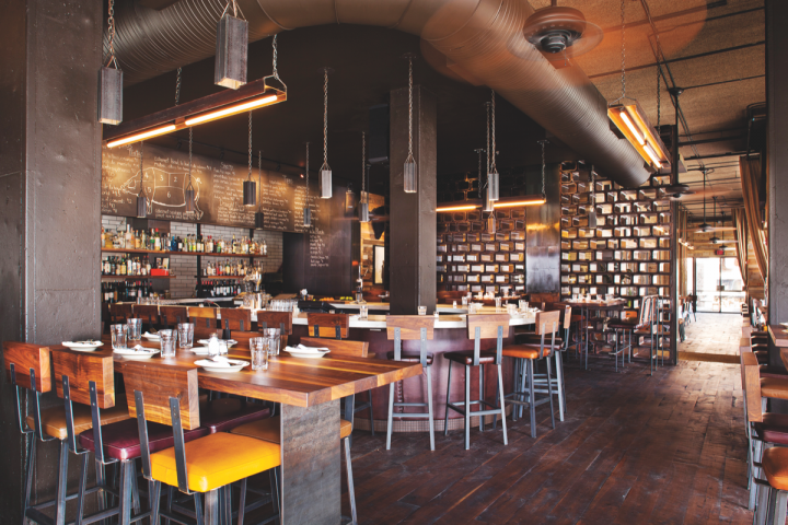 Though each Barcelona Wine Bar location is designed for its individual market, they all share industrial interiors and an intimate atmosphere (Atlanta's Inman Park location pictured).