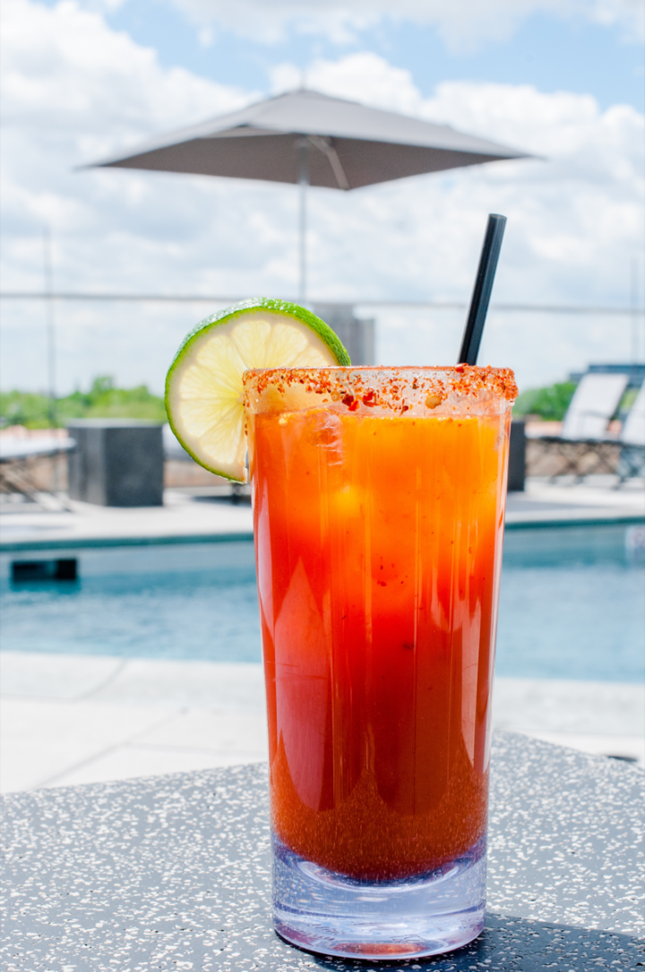 Atop The Robey in Chicago, the Cabana Club serves a Michelada, blending Tecate beer, lime juice, and Cholula Original and Valentina Salsa Picante Mexican hot sauces. The drink serves as a low-alcohol cocktail option.
