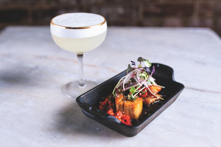 Such signature drinks at Taste Bar as the Club Trip are complemented by a menu of small plates (Club Trip and pork belly pictured).