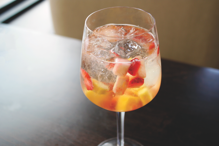 The Moon Catchin' Sangria at 312 Chicago is a blend of white wine, triple sec and peach liqueur with fresh strawberries, raspberries and pineapple.