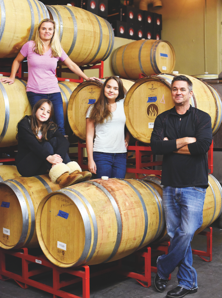 At Woodinville, Washington's Sparkman Cellars, owner Chris Sparkman and his wife, Kelly, produce 12,000 cases of wine a year and distribute it as far as Kansas (Sparkman family pictured clockwise from left: daughter Ruby Leigh, Kelly, daughter Stella Mae and Chris).