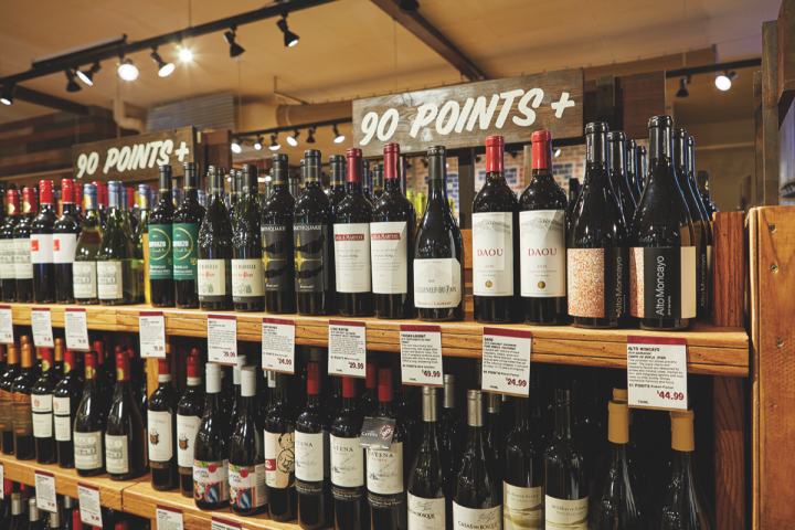 One section of each store is dedicated to displays of 90-plus rated wine labels.