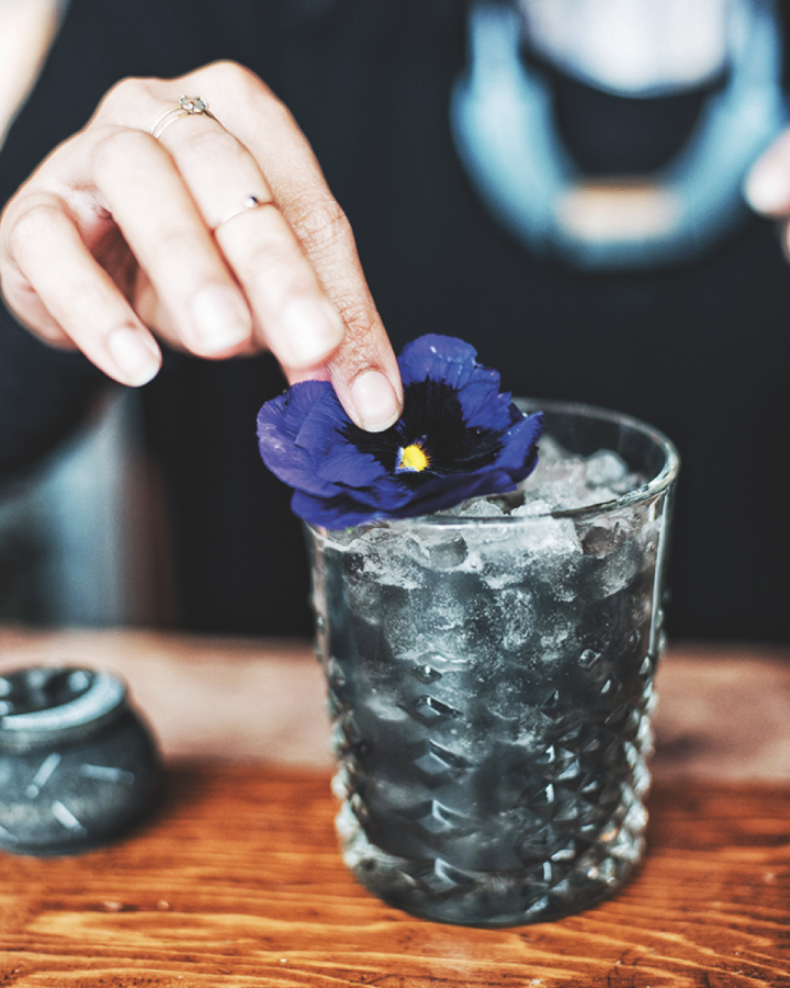 The Reanimator at Cindy's Rooftop Restaurant in Chicago mixes fersh blueberries and ginger, Demarara sugar, and lime juice with a house-made charcoal syrup and Avuá Prata cachaça.