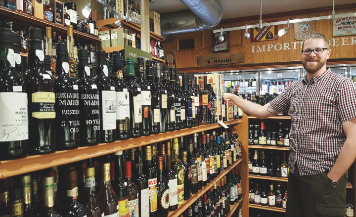 Ball Square Fine Wines specialty spirits and beer manager Nate Kruback offers 35 vermouths at his store.
