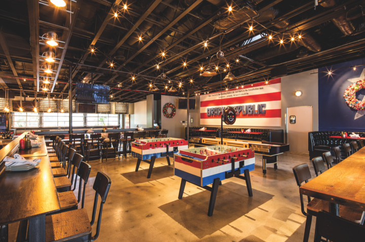 At Cohn's more laid-back, beer-centric venue Draft Republic in La Jolla, California, guests can play a variety of tabletop games, including foosball (above) and ping pong.