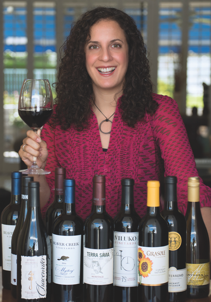 Organic Wine Exchange founder Ann Arnold (above with a selection of her site's offerings) curates a comprehensive online portfolio of certified organic wines sourced from across the globe.