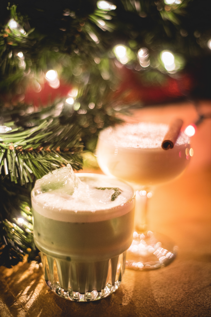 At Donner and Blitzen's Reindeer Lounge in New York City, the Elf Nog (left) blends fernet, creme de menthe, cacao and cream, while the Nog-Gonna Make It To Work Tomorrow comprises egg nog, orgeat and aged rum.