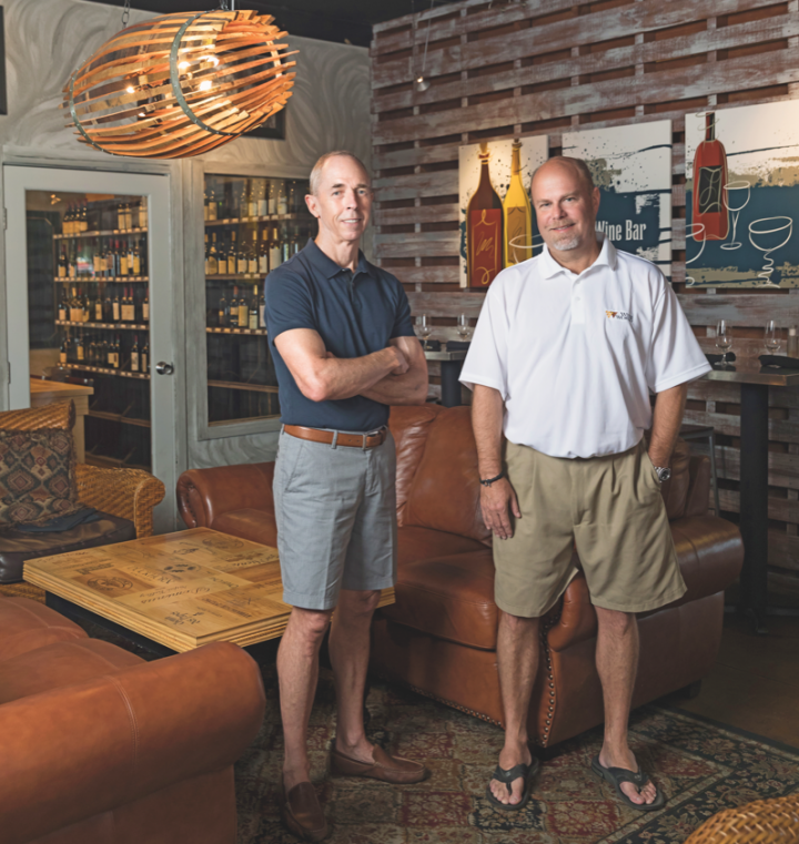 Wine World owner Chan Cox (left) and business manager Darren Moss (right) have successfully incorporated an on-premise ingredient into their retail stores.