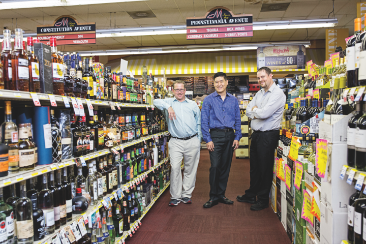The Magruder's team includes wine and spirits manager Bill Townsend (left), current owner Ki Yoon (center) and sales manager Ben Page (right). Yoon acquired the store in 2013.