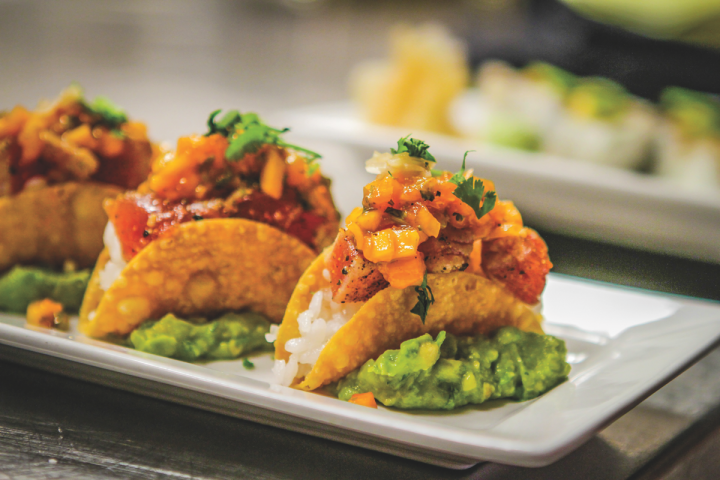 Tag Restaurant (OG sushi taco pictured), Tag's flagship restaurant, serves multicultural cuisine and emphasizes locally sourced ingredients.