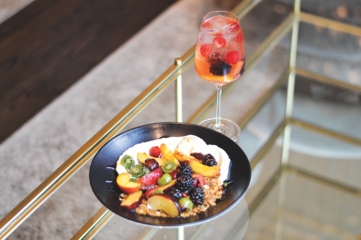 Ella Elli is globally focused, with its food and drinks menus taking inspiration from a variety of cultures. The restaurant has both brunch (greek yogurt dish and cocktail pictured) and dinner services.