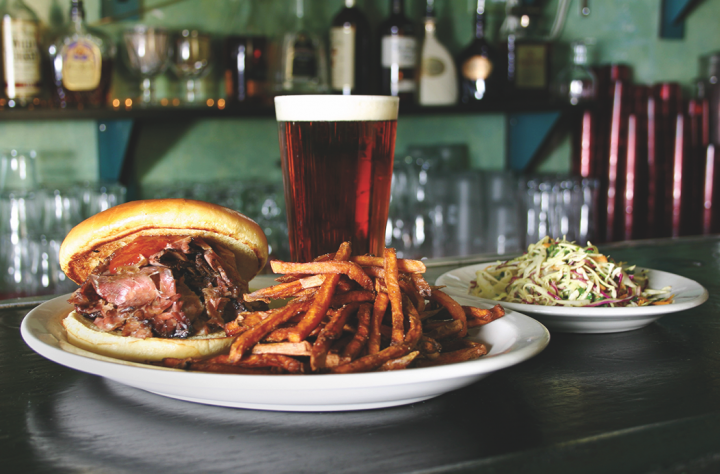4 Star's barbecue concept Smoke Daddy (smoked sliced brisket sandwich and beer pictured) is opening its second outpost in the Hotel Zachary near Wrigley Field this spring.