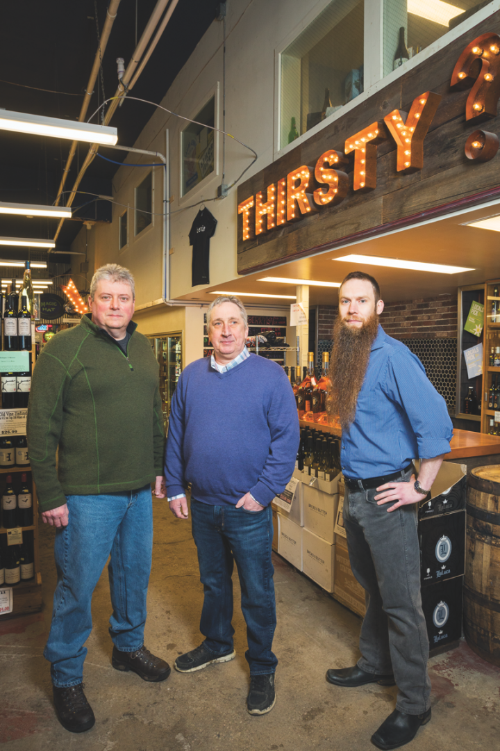 (From left): Beverage Warehouse minority owner George Bergin, general manager Todd Delbeck, and wine and beer manager Jason Dennis.