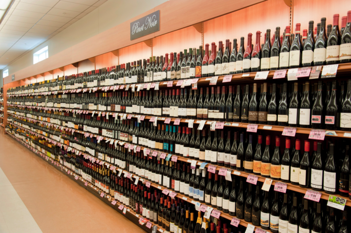 Franzia, Barefoot, and Woodbridge are among the top ten wine brands at the NHLC (wine shelving pictured at Nashua store).