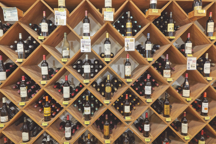 Wine comprises 25% of sales at Jensen's. High-end offerings are displayed in wooden boxes (pictured) on the store's wine wall, which also has a wine closet to hold the most premium bottles.