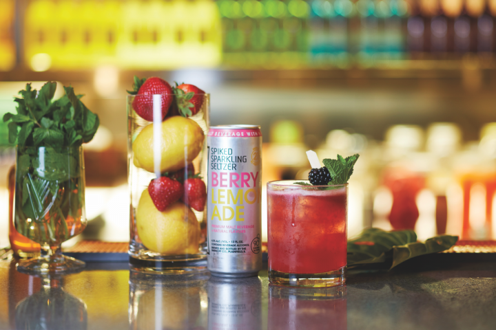 Hard seltzers are capitalizing on the same flavors as other beverage categories, pushing fruit-based offerings (Diageo's SmirnoffSpiked Berry Lemonade pictured) for the summer.