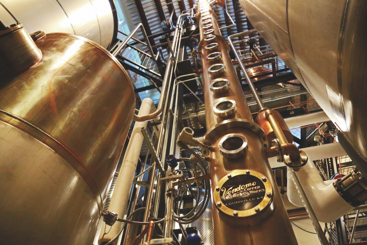 Colorado's natural resources, particularly its mountain water, are key to the state's craft distilleries. Breckenridge Distillery (stills pictured) in Breckenridge produces Bourbon, rum, vodka, and gin using Colorado water and local ingredients such as slope fruits.