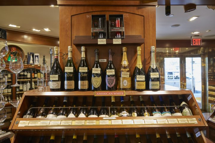 Sam Aaron, brother of Sherry-Lehmann founder Jack Aaron, crafted the store's image in fine wine (white wine and Champagne display above), making it a destination for consumers from around the world.