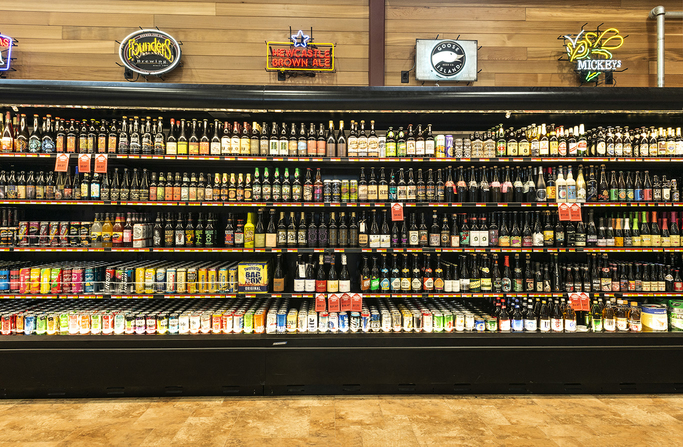 Happy Harry's Bottle Shops (beer shelf pictured) often provide beverages for charity events held in support of the Empire Arts Center in Grand Forks, North Dakota,